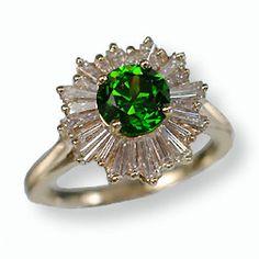 //1 carat demantoid garnet surrounded by 0.9 ctw of baguette diamonds