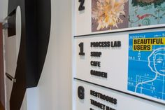 Colorful graphic directories, with changeable magnetic panels, highlight exhibitions on each floor.