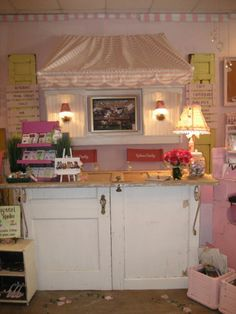 Retail Details blog June 2012 Uptown Country Home FB door cashwrap  ~I'm looking for ideas for a cash wrap counter that I bought from The Great Indoors since they are going out of business. This is too shabby chic for our salon, but I love it!