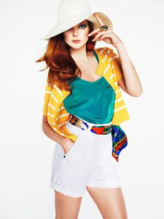 White shorts. Pops of tropical color. A huuge hat of course. Mango