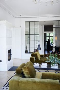 black and white living room with chartreuse velvet seating