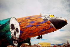 graffiti painted world war II military planes-'untitled' by nunca, 2011,  spray paint on dc3 aircraft