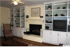 Love the built ins and cabinets around the fireplace