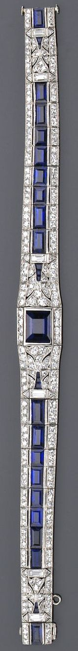 ❦ An Art Deco sapphire, diamond and platinum bracelet, circa 1925  of tapering design, centering a rectangular-cut sapphire flanked by rows of calibré-cut sapphires and accented with old European-cut diamond borders, millegrain setting; estimated total sapphire weight: 8.50 carats; estimated total diamond weight: 3.40 carats.