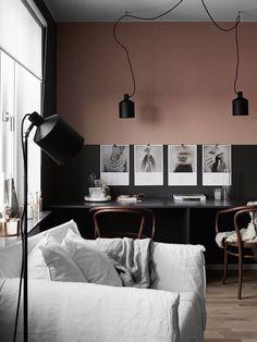 peinture mur bicolore associant noir et rose pour délimiter visuellement le coin repas