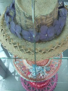 My total favourite was the glass display cabinet with a series of hats from the Cook Islands. These hats are a wonderful artform with intricate weaving and the glowing colours of the flowers around the brim. My Roots, Cook Islands, Hanging Chair, Bassinet, Fashion Shoes, Weaving, Colours, Display, Dreams
