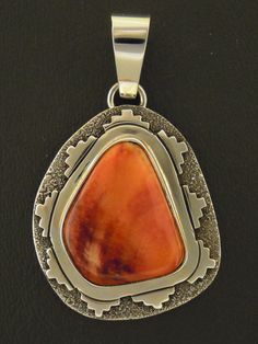 Spiny oyster pendant is Native American handmade of sterling silver by Navajo silversmith Sam Gray.