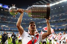 Gonzalo Martinez of River Plate celebrates with the trophy at the end. River Tattoo, Atlanta, Plates, Celebrities, Madrid, November, Football, History, Breakfast Nook