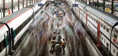 a long-exposure shot captures commuters leaving a swiss federal railways (sbb) train at the main station in lucerne. the most populated city in central switzerland, lucerne serves as a regional transportation and government hub.