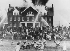 Football game continues as school burns, 1965 (location unknown)