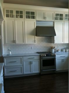 love the stacked cabinets, subway tile and floors