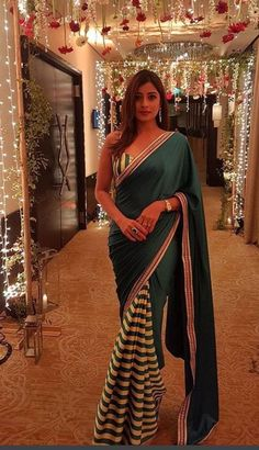 Emerald green saree with stripes on front pleats and striped spaghetti strap blouse Saree Jacket Designs, Sari Blouse Designs, Saree Blouse Patterns, Lehenga Designs, Indian Beauty Saree, Indian Sarees, Indian Dresses, Indian Outfits, Indische Sarees