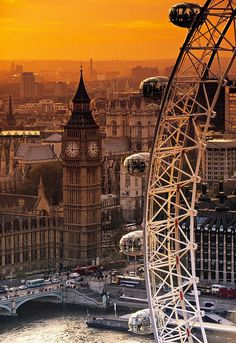 The London Eye is a work of modern architecture in a city of old charm. What a beautiful sunset background - London, England