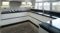 We are used to working with architects, interior designers, main contractors, builders and private developers. This can be for individual rooms or for a multitude of stone surfaces across a . Modern Kitchen Cupboards, Black Granite Kitchen, High Gloss Kitchen Cabinets, White Gloss Kitchen, White Cupboards, Black Kitchens, Black Backsplash, Black Countertops, Grey Kitchen Designs