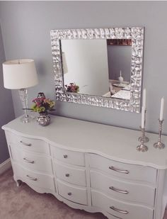 A perfect decor arrangement. I love the look of the modern mirror with an antique chest of drawers. To me, this is the perfect amount of items to leave out on a surface. I don't like clutter at all! :)