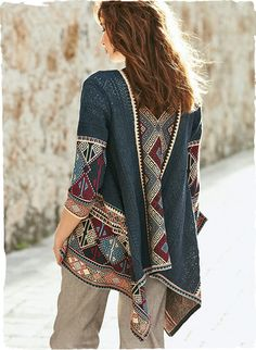 An intriguing mix of patterned lace and jacquard knit kilim geometrics gives this pima cardigan its dramatic beauty. Hued in versatile shades of denim, limestone, charcoal and madder red, the drapy, voluminous silhouette is balanced with slim ¾-sleeves.
