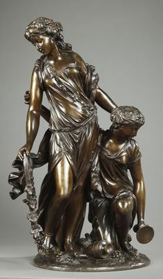 An important bronze group with brown dark patination representing two bacchantes in Clodion style, dressed à l'antique and wearing in their hair garlands of vine leaves. One of them...