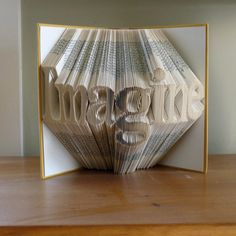Best Selling Item - Unique Present - Custom Folded Book Sculpture -  Imagine - Your Choice of Words - Great Gift... on Etsy, $225.00...wonder if I could make this?