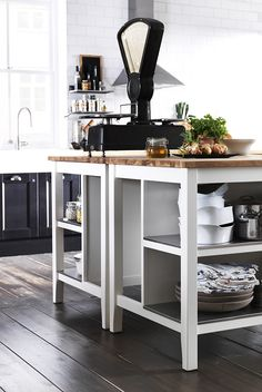 Love the colours of this kitchen. Especially the butcher block island
