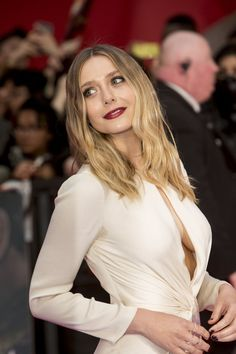 Elizabeth Olsen at Captain America premiere with elegant cleavage
