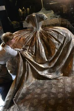 The wedding gown of Hedwig Elisabeth Charlotte of Holstein Gottorp, Queen of Sweden and Norway. Made in 1776 of cloth of silver and silver lace. The bride was 16. (The photo: the gown being prepared for exhibition.)
