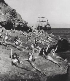 Actresses playing mermaids lounge during the filming of Peter Pan. 1924.