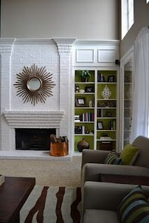 White fireplace - maybe we need to paint it white. I'm against hiding the natural but our brick color is very hard to decorate around