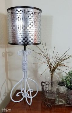 Lamp shade from metal and 2 embroidery hoops. I could use this for my beedside lamps. =D