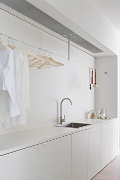 And, the editors' favorite feature of this sleek, streamlined laundry room is none other than a clever Ikea hack. See if you can spot it, then read more in Design Sleuth: One of the Most Ingenious Ikea Hacks Ever. Photograph by Shannon McGrath. Ikea Laundry Room, Laundry Room Organization, Ikea Utility Room, Storage Organization, Modern Laundry Rooms, Laundry Area, Küchen Design, House Design, Interior Design