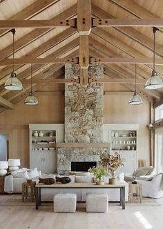 Barn House Stone Fireplace Vaulted Ceiling More House tour of a magnificent beach barn house by Hutker Architects and Martha's Vineyard Interior Design. Vaulted ceilings, exposed beams and ocean views. Stone Fireplace Designs, Stacked Stone Fireplaces, Fireplace Ideas, Fireplace Update, Fireplace Stone, Fireplace Furniture, Beach Style Fireplaces, Fireplace Filler, Modern Fireplaces