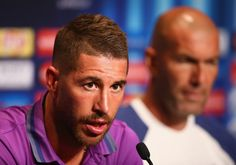 In this handout image provided by UEFA, Sergio Ramos talks to the media as Head Coach Zinedan Zidane listens during the Real Madrid Press Conference at Lerkendal Stadion on August 8, 2016 in Trondheim, Norway.