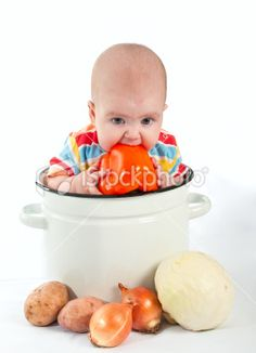 af1ee93d541 Baby sitting in the big saucepan with vegetables. Royalty Free Stock Photo  Royalty Free Images