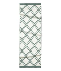 Green. Oblong cotton rug with a jacquard-weave pattern. Reversible.
