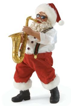 "Saxy Santa - African American- ""Saxy Santa, and boy how he can handle a Saxophone! A wonderfully musical black Santa Claus figure and crafted from stiffened fabric and resin, this eye-catching figure is skillfully hand-sewn and hand-painted with exceptional attention to detail. Uncanny realism that adds up to a one-of-a-kind Christmas experience for everyone who falls under the Possible Dreams clothtique spell."