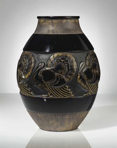 MARIUS-ERNEST SABINO (1878-1961) A VASE, CIRCA 1930 black glass, with gilding 14 in. (36 cm.) high signed Sabino Paris with original paper label