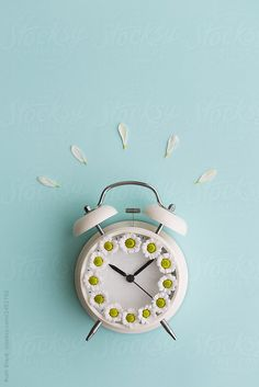 Alarm clock with daisies by Ruth Black for Stocksy United