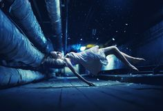 Zero Gravity - Nikolay Tikhomirov.    I love this series of photographs.  From the floating figures to the coloring, everything is really beautiful about this picture.