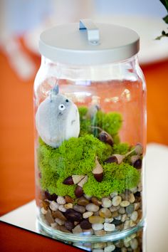Cool part--have nice looking centerpieces and then add in that tiny bit of geekery.  I'd prefer something small it takes a minute to find...   Geeky terrarium centerpieces FTW! | Offbeat Bride