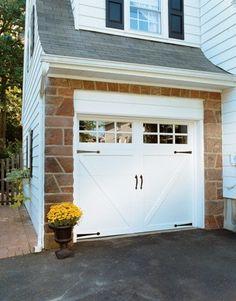 White garage door with decorative hardware