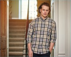 Actor Sam Heughan dons a Barbour tartan shirt $95.13 for the label's spring-summer 2017 campaign.