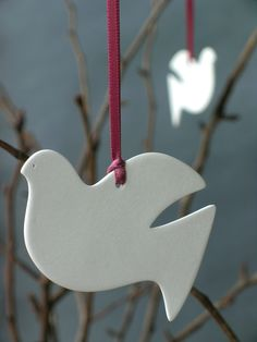 A pretty flat porcelain dove. Approximately 2 inches high.    Comes with a colored ribbon to hang it by.    Great for Christmas, Valentines, Easter, weddings, Christenings, Thanksgiving or to decorate your home all year round!