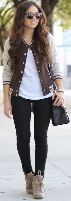 Sporty chic.  The athletic inspired trend is big for fall 2014.  Try a baseball/varsity jacket.