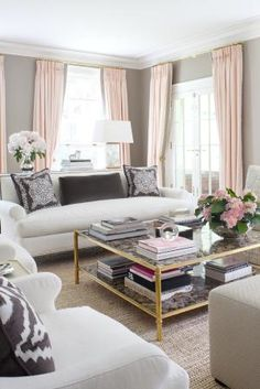This pale pink, gray and gold living room is the epitome of feminine, glamorous style, with subtle patterns, inviting seating for guests, and hints of gold. Love!