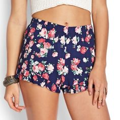 Floral Ruffle Soft Shorts Navy blue floral soft shorts from forever 21 with floral pattern and ruffled hem. Semi-high wasted. Worn only a few times! Great condition and super cute. Forever 21 Shorts