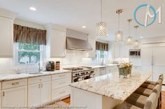Golden Eagle Granite with off-white kitchen cabinets