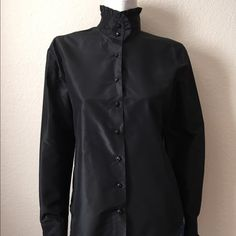 Ralph Lauren Silk Blouse Ralph Lauren Silk Blouse comes in black silk, is unworn with tags attached, ruffle neck and sleeve detail with additional button attached. Size: 8. Ralph Lauren Tops Blouses