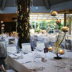 5 arm candelabra dressed with white Singapore orchids and crystals at one of our partner venues, The Terrace | Bouquet Melbourne