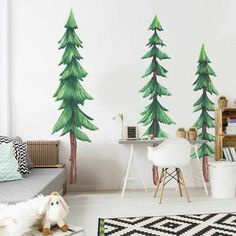 Create the ultimate woodsy vibe with Our Set of 3 Pine Tree Watercolor Wall Decal Set. These pine trees are perfect for a new nursery or a Forest themed kids room. The Kit includes 3 large Pine tree decal split into multiple pieces.