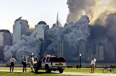 The North Tower of the World Trade Center dissolves in a cloud of dust and debris about a half hour after the first twin tower collapsed, on...