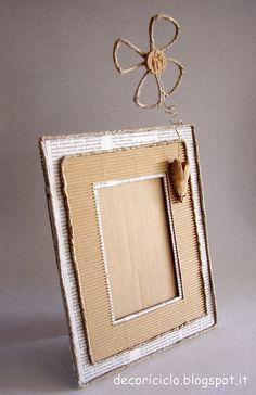 portafoto di cartone, carta giornale, cartoncino, sughero, metallo e spago 2 by decoriciclo, via Flickr